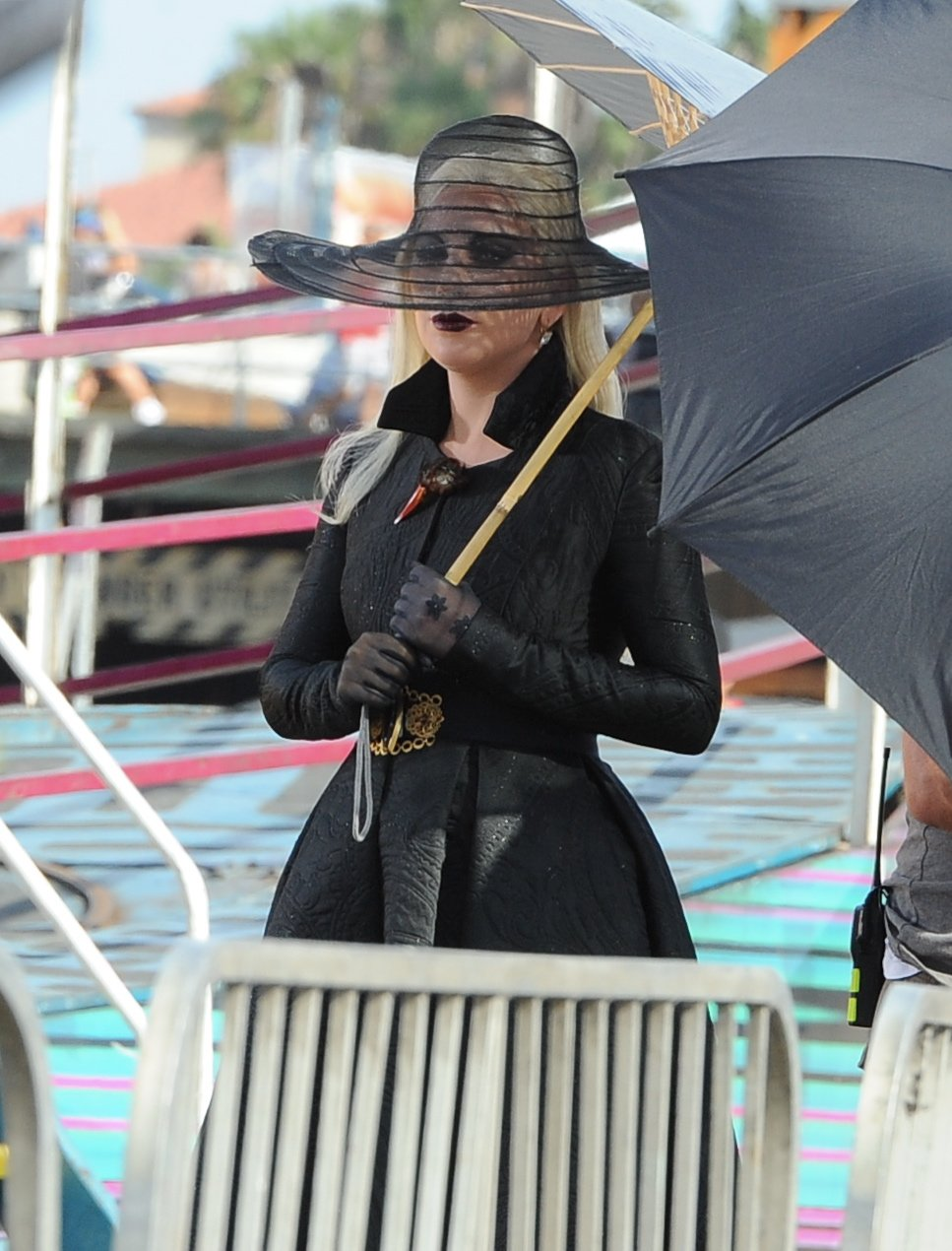 """Countness Lady Gaga dress in all black for a beach carnival scene in Santa Monica for """"American Horror Story Hotel"""" with co star Wes Bentley. The singer walk around the sand with black heels in a scorching hot day but had help with umbrellas and water fan for the crew.  Featuring: Lady Gaga Where: Santa Monica, California, United States When: 10 Sep 2015 Credit: Cousart/JFXimages/WENN.com Countness Lady Gaga dress in all black for a beach carnival scene in Santa Monica for """"American Horror Story Hotel"""" with co star Wes Bentley. The singer walk around the sand with black heels in a scorching hot day but had help with umbrellas and water fan for the crew.  Featuring: Lady Gaga Where: Santa Monica, California, United States When: 10 Sep 2015 Credit: Cousart/JFXimages/WENN.com"""