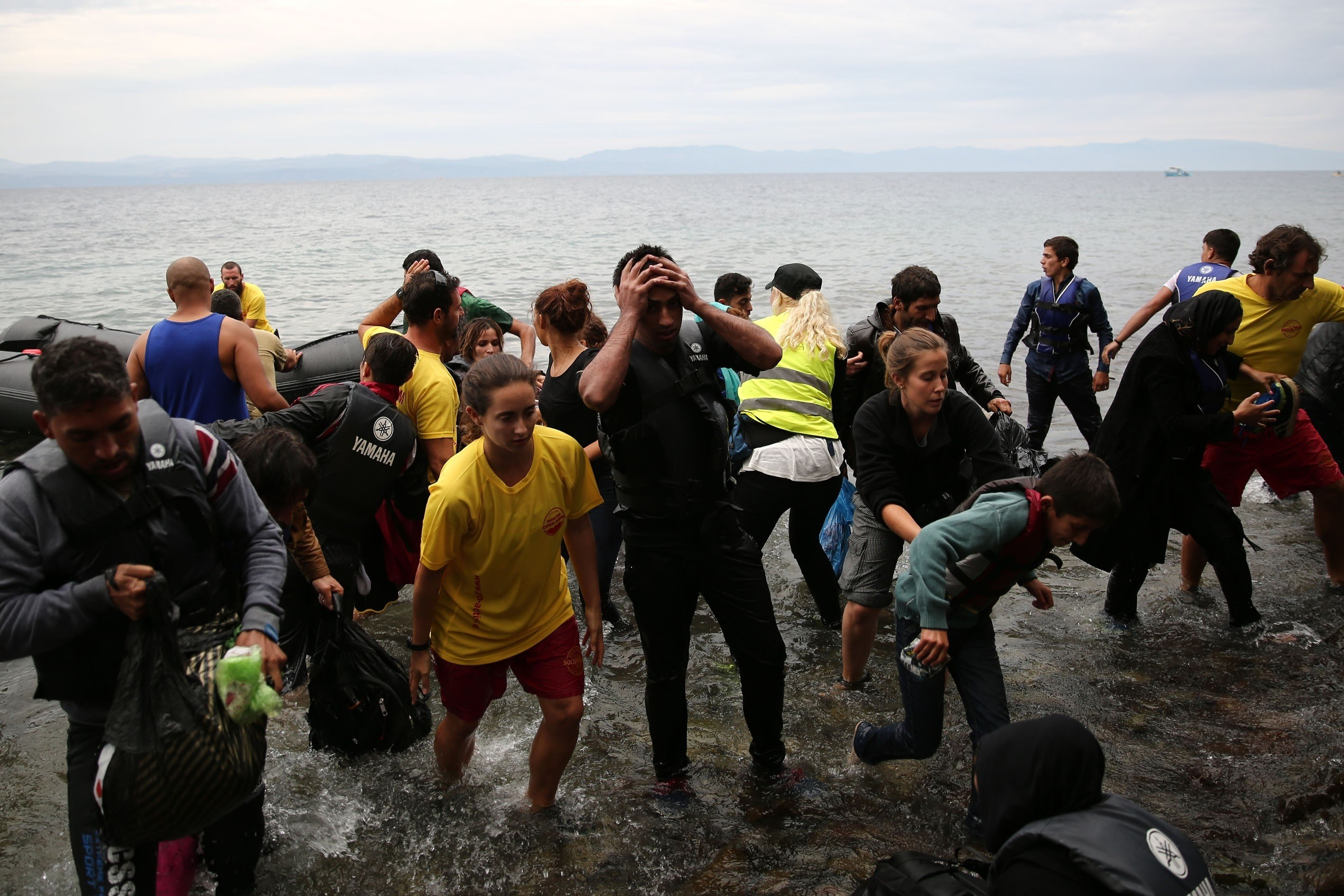 Refugees are seen after they arrived in Greece's Lesbos Island on October 10, 2015. Refugees who begin a journey with a hope to have high living standards away from conflicts, use Greece's Lesbos Island as a transit point on their way to Europe. Photo by Ayhan Mehmet/AA/ABACAPRESS.COM